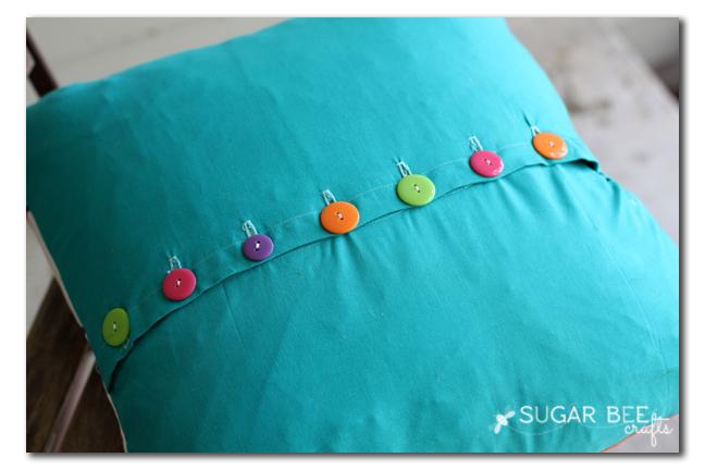 rainbow button envelope pillow closure