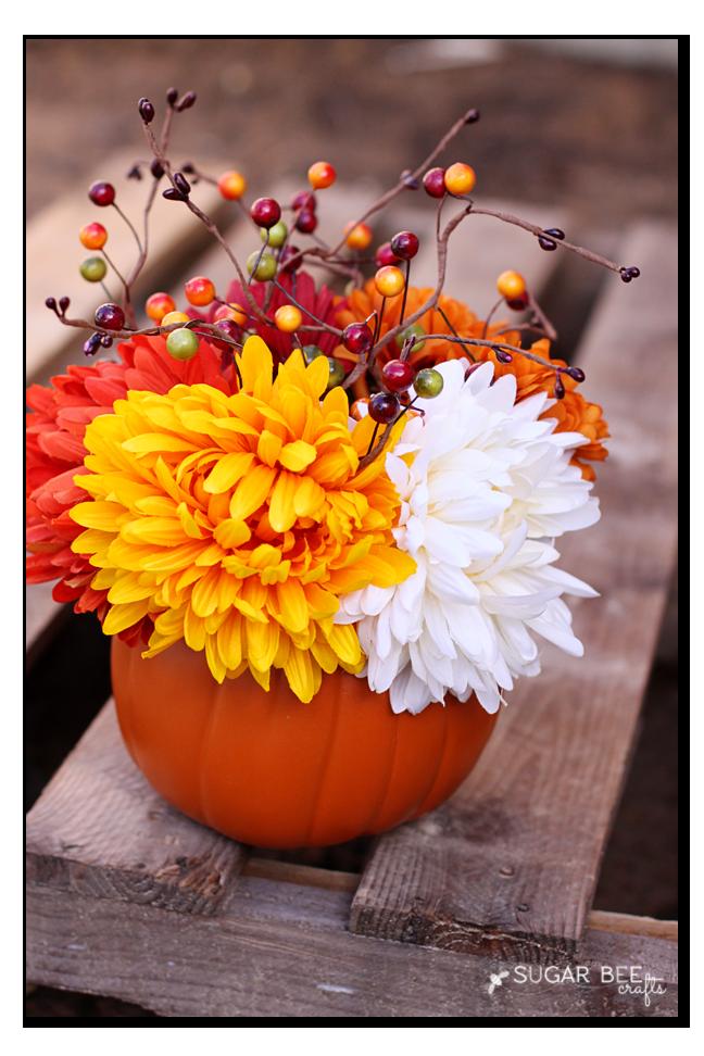 fall flowers in a pumpkin - cute craft idea!
