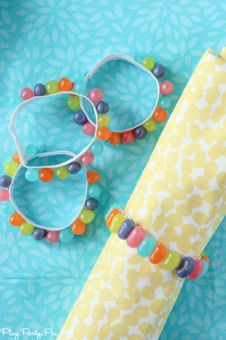 Easy DIY spring napkin rings made from a little bit of elastic, jelly beans, and hot glue. Perfect addition to any spring party!