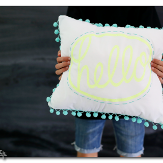 Diy pom pom hello pillow