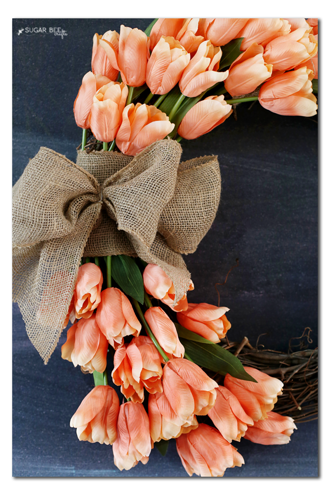faux tulips into wreath
