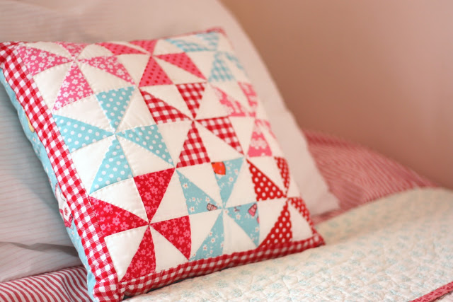 red pink aqua pinwheel quilt pillow