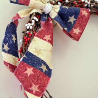 Tie a scrap of fabric into a bow and tie onto wreath for a cute finishing touch