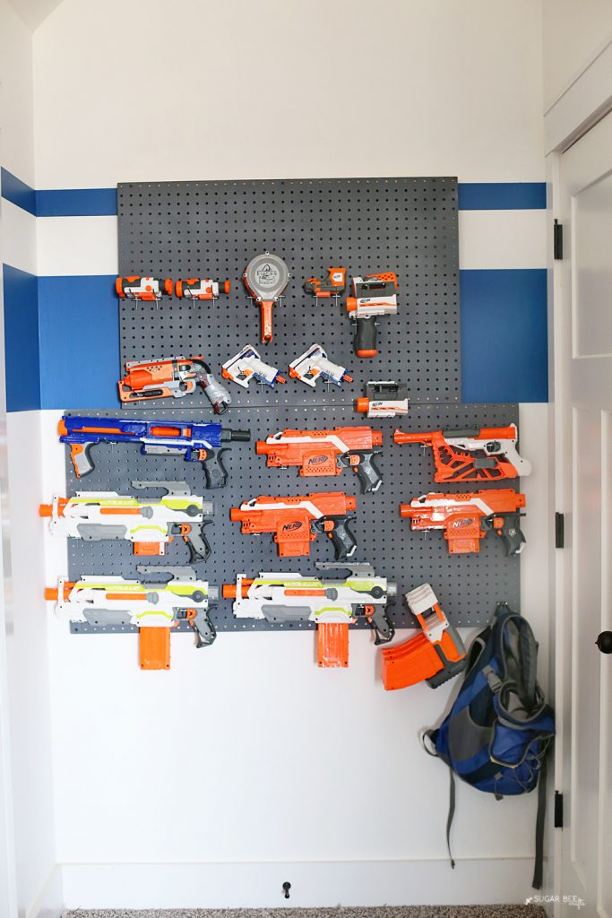 behind door nerf wall pegboard storage organization solution