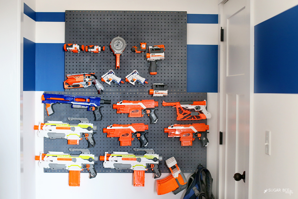 Nerf gun storage in my son's closet. Super easy, went to Lowe's for 2 peg  boards, bought the hardware at Lowe's, total price $18. Worth every penny  to have ...