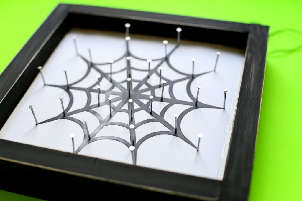 Spiderweb string art halloween craft idea 32
