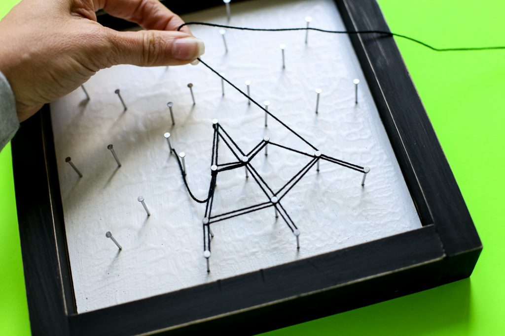 Spiderweb string art halloween craft idea 35