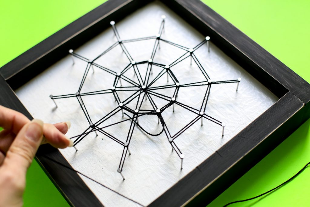Spiderweb string art halloween craft idea 36