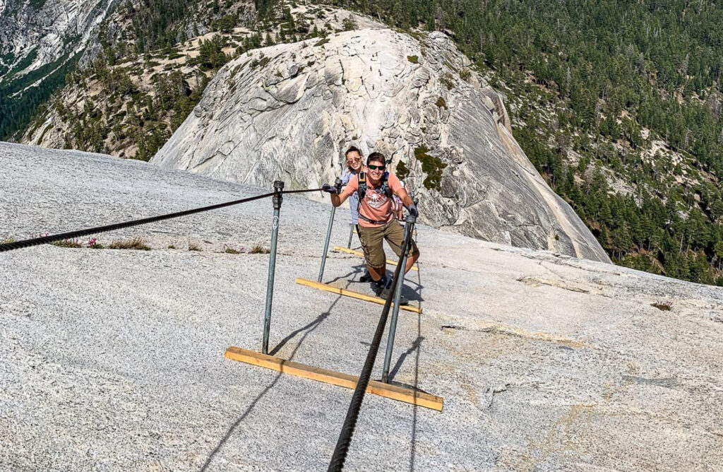 boy and girl on half dome cables
