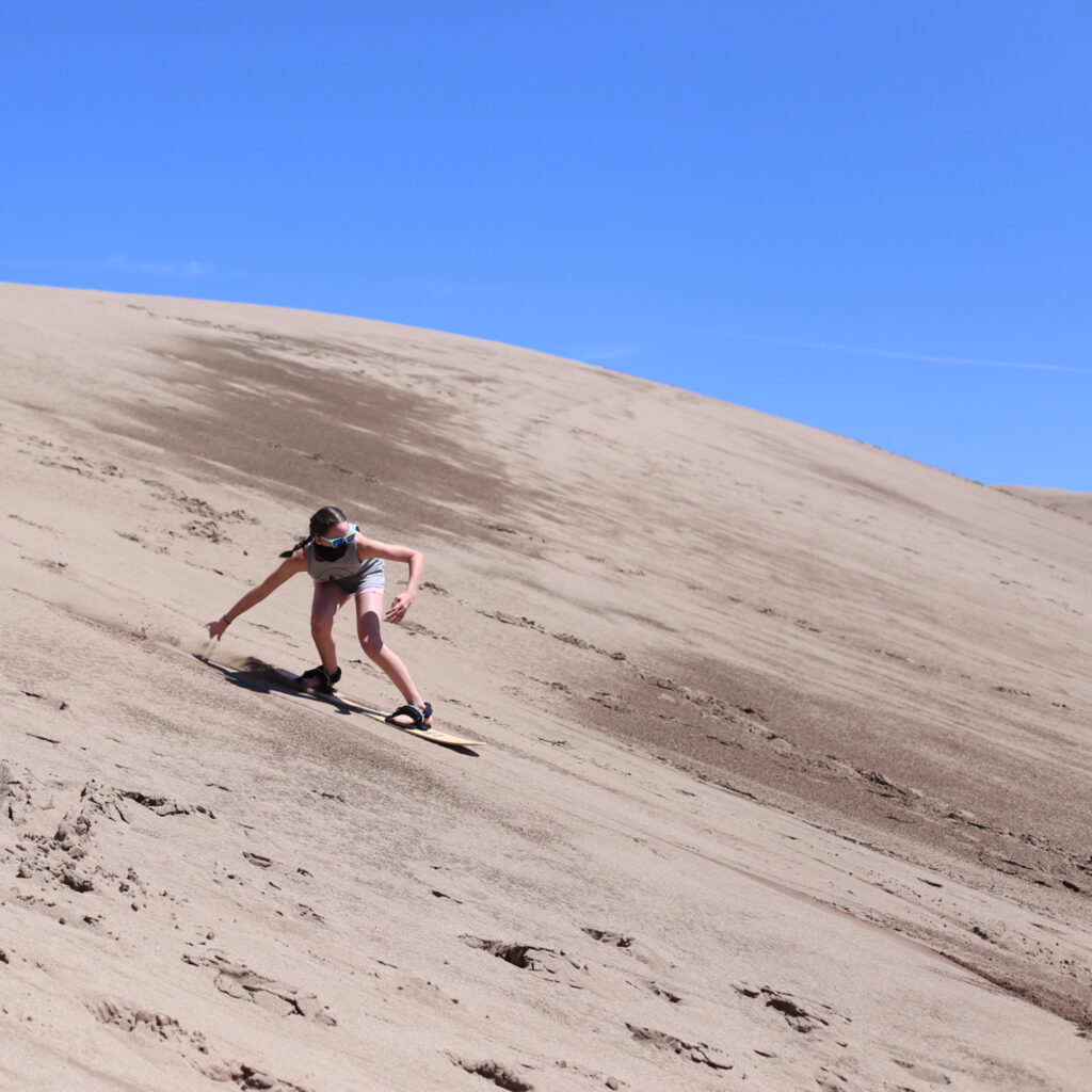 Sandboarding and sledding at great sand dunes 1