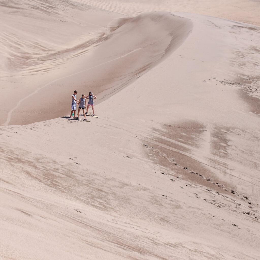 Sandboarding and sledding at great sand dunes 3