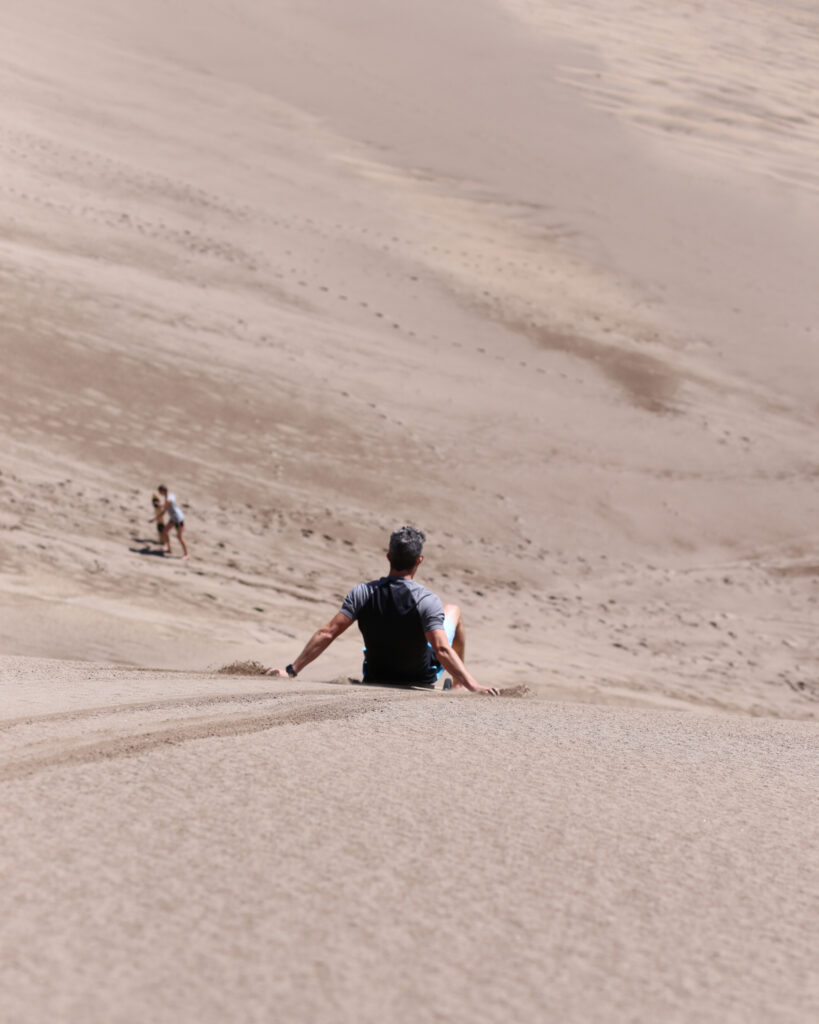 Sandboarding and sledding at great sand dunes 4