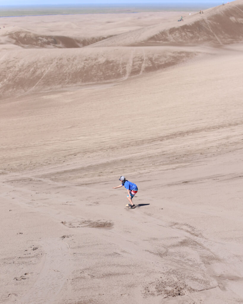 Sandboarding and sledding at great sand dunes 5